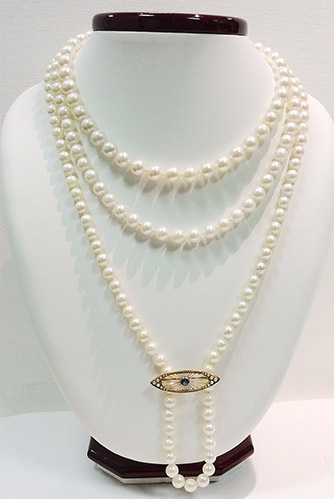 pearl-triple-broche